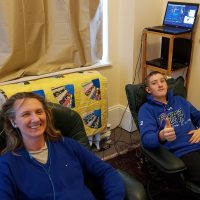 mother and son hooked up to neurofeedback sensors in office